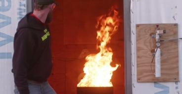Employee performing a fire suppression test in a contained structure.