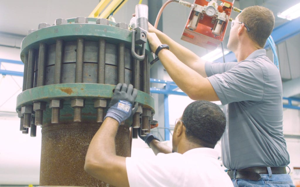 Two employees working on pressure relief device