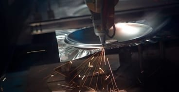 rupture disc production shot using laser to remove excess part